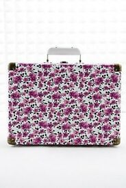 Crosley cruiser record player with pink/purple flowers