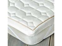Superking size extra thick memory foam mattress topper.