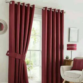 Pair of Dunelm eyelet red lined curtains