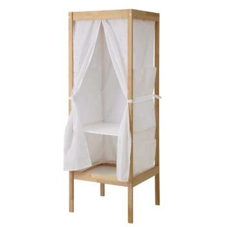 IKEA Sniglar wardrobein Southsea, HampshireGumtree - Selling a Sniglar wardrobe from IKEA. Bought for my daughter and great for childrens clothes. Features One solid shelf One velcro shelf. Sides and front of wardrobe made of material and velcro on One metal hanging rail Side storage pockets Dimensions...