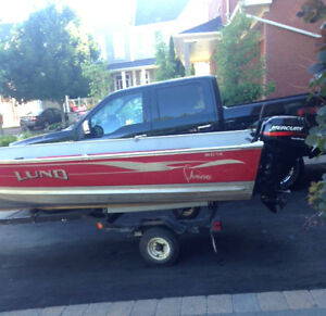 14 foot Lund boat, motor and trailer