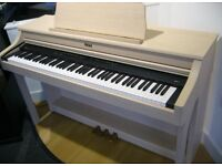 Roland HP204 - Like new and comes with matching Roland piano stool