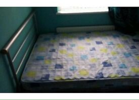 Double bed and mattress.