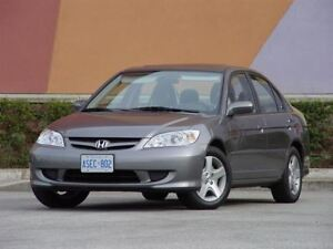 A very high mileage 03-05 Honda Civic or Acura EL (manual only)