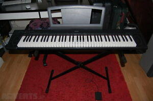 Yamaha 76 key portable electric piano with stand & sustain pedal
