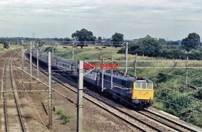 PHOTO  COLWICH RAILWAY STATION SITE STAFFORDSHIRE 1986 ELECT LOCO PASSING LNWR E