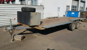 20x8 flat deck utility trailer with tool box.