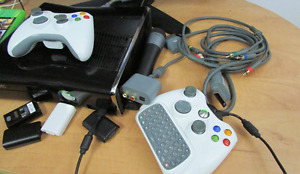 Xbox 360 S, 2 controllers, 4 games & and a lot of stuff