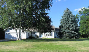 Country Living..Sprawling Rancher...An acre lot...on the River.