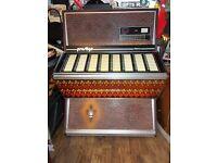 Vintage and very retro NSM Prestige Jukebox, with a fleur de lys colour styling.