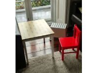 Small ikea table, red wooden chair and plastic chair