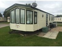 Caravan for hire on Presthaven beach resort, North Wales.
