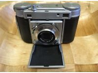 Camera with leather case