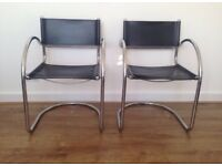 Set of two leather and chrome cantilever chairs