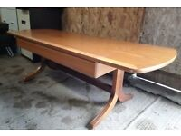 Wooden coffee table with drop down ends, great quality with curved legs, attractive table