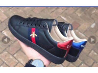 Brand new Gucci trainers black with red/blue. Unisex size 8.