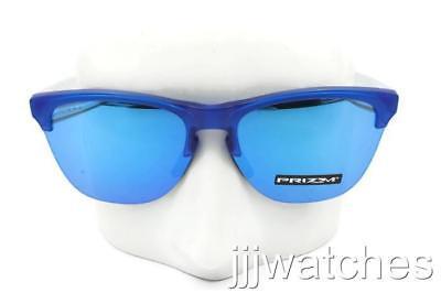 a7cba2c5dc Oakley Frogskins Lite Matte Translucent Sapphire Iridium Sunglasses OO9374  07 63