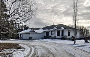 $645,000.00 for a 2000 sq ft  Acreage with a walkout basement