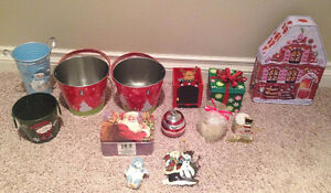 assorted Christmas tins, candles and ornaments
