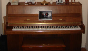 Samick Piano with matching bench.