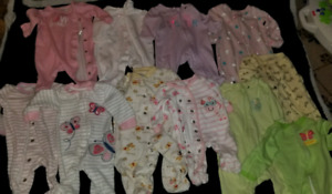 Girls sleepers, onesies and dresses. Sizes 0 to 6 months &12