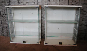 two glass display cabnets