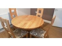 Round oak table and 4 chairs from oak furniture land - 18 months old
