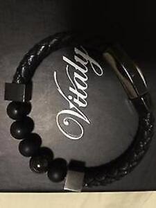 New in case black beads with braided leather bracelet