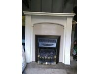Gas fire with surround, hearth and backplate