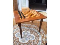 Vintage wooden chess table and pieces