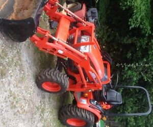 Compact tractor with bachoe service