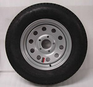 NEW TRAILER TIRES 205-75-15 AND FENDERS AND SPARE MOUNTS