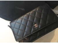 Authentic Chanel WOC wallet on chain black lamb skin.