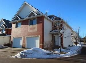 Incredible Value on This Brick Faced Townhome Backing Onto Park!