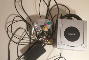 GAMECUBE WITH 3 GAMES FOR $65 . COMES WITH ACCESSORY