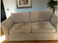 Three seater sofa with matching arm chair in excellent condition