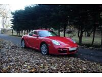 PORSCHE CAYMAN, excellent condition with very low mileage.