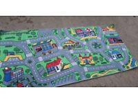 Play mat for children with city scene. Fun and bright carpet mat for games for kids
