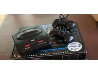 SEGA Mega Drive II with 2 control pads and 11 games