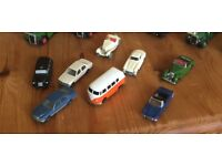 Metal model buses and cars .