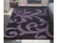 Black and purple rug