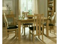 Oak dinning room table and chairs with matching sideboard and display cabinet.