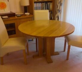 Round light oak dining table. NEW REDUCED PRICE!