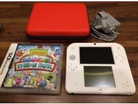 Nintendo 2 DS with red case, charger and game