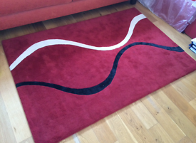 Husain red rug with black and white stripe