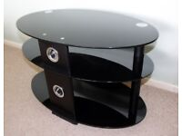 Oval Black Glass Television Stand.