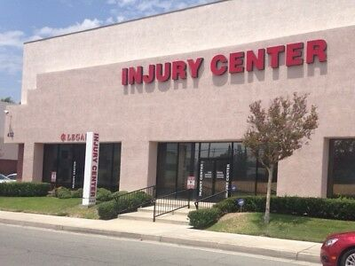 Illuminated Channel Letters Signs Reading Injury Center 34 And 29 Inches