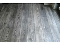 Charcoal and light grey 8mm laminate 20m2 fitted £320
