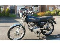 Dark blue Honda CG 125 classic motorbike bike 1980