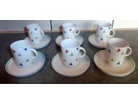 Espresso size. Coffee cups and saucer. Fine china set. German. Bunting pattern.